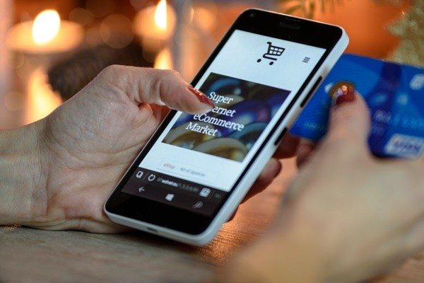 Person Using Phone Ecommerce